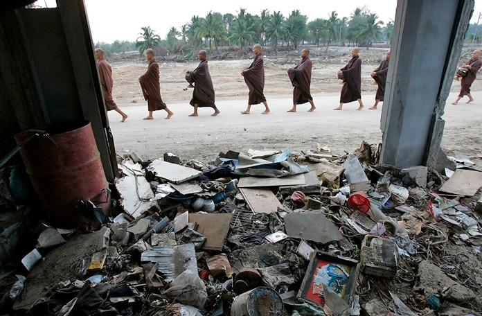 In this Jan. 19, 2005, filer photo, Buddhist Monks from the Asoke community of Bangkok, walk through the Dec. 26, 2004, tsunami-devastated community of Ban Nam Khem, Thailand, as part of a pilgrimage. (AP Photo/David Longstreath)