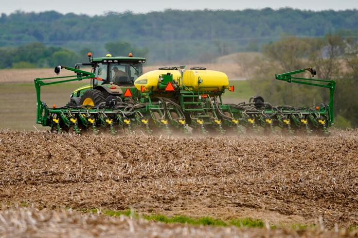 In this May 23, 2019, file photo, a farmer plants soybeans in a field in Springfield, Neb. China's imports of soybeans surged in November following the announcement of an interim trade deal with the United States. (AP Photo/NatiHarnik, File)