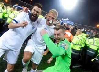 Finnish captain Tim Sparv, left, celebrates with Paulus Arajuuri, center, and goalkeeper Lukas Hradecky after their victory in the Euro 2020 Group J qualifying soccer. Stock up on beer. The Finns are coming. That's the message from Finland goalkeeper Lukas Hradecky as his country prepares to play at soccer's European Championship for the first time in 2020. (Markku Ulander/Lehtikuva via AP)