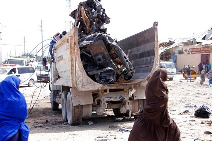 A truck carries wreckage of a car used in a car bomb in Mogadishu, Somalia, Saturday, Dec. 28, 2019. (AP Photo/Farah AbdiWarsame)