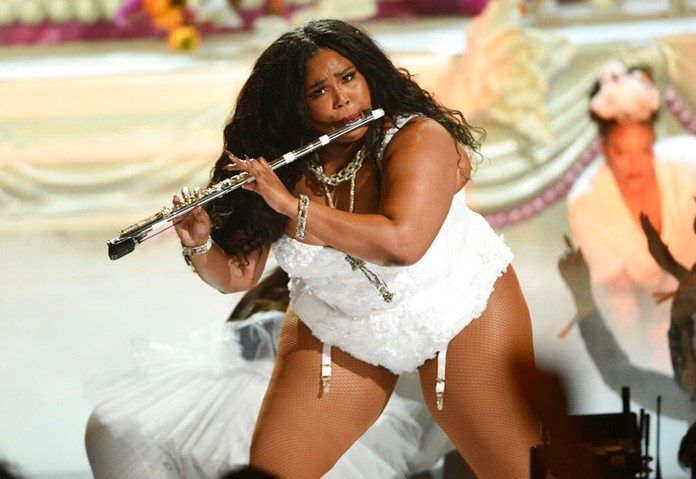This June 23, 2019 file photo shows Lizzo playing the flute at the BET Awards in Los Angeles. Lizzo has been named Entertainer of the Year by The Associated Press. (Photo by Chris Pizzello/Invision/AP, File)
