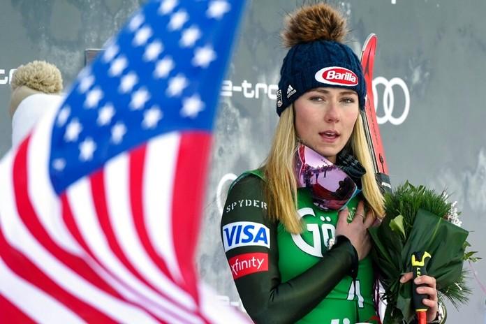 United States' Mikaela Shiffrin, winner of an alpine ski, women's World Cup giant slalom, listens to the national anthem, in Lienz, Austria, Saturday, Dec. 28, 2019. (AP Photo/Piermarco Tacca)