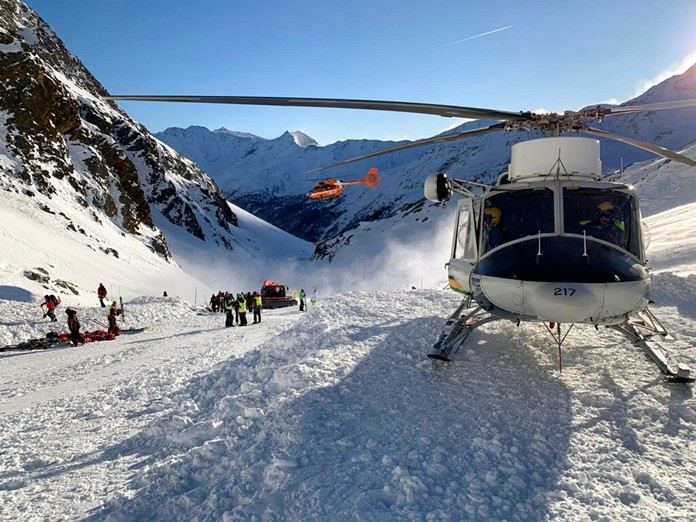 Rescuers at work following an avalanche in Val Senales, Saturday, Dec. 28, 2019.(ANSA via AP)