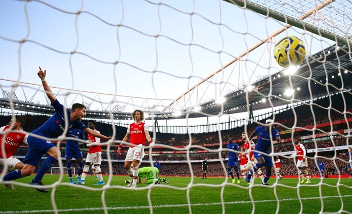 Chelsea's Jorginho, left, celebrates after scoring his side's first goal during the English Premier League soccer match between Arsenal and Chelsea, at the Emirates Stadium in London, Sunday, Dec. 29, 2019. (AP Photo/Ian Walton)