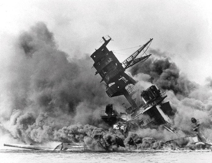 In this Dec. 7, 1941 file photo, smoke rises from the battleship USS Arizona as it sinks during the Japanese attack on Pearl Harbor, Hawaii. (AP Photo, File)
