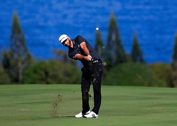 In this Jan. 7, 2017, file photo, Dustin Johnson hits for the fourth fairway during the third round of the Tournament of Champions golf event at Kapalua Plantation Course in Kapalua, Hawaii. The course has gone through a refinement to prepare for the winners-only event on the PGA Tour that starts Thursday, Jan. 2. (AP Photo/Matt York, File)