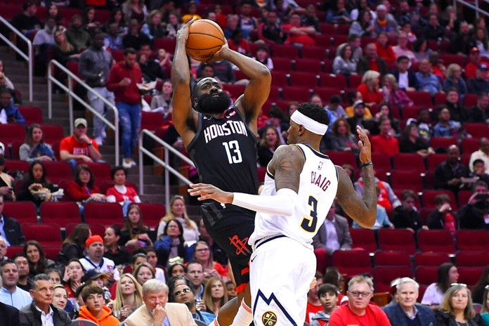 Houston Rockets guard James Harden (13) shoots as Denver Nuggets forward Torrey Craig defends during the second half of an NBA basketball game, Tuesday, Dec. 31, 2019, in Houston. (AP Photo/Eric Christian Smith)