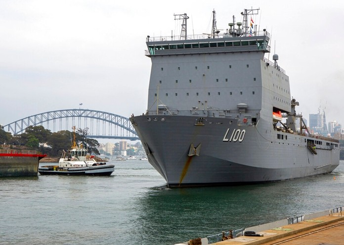 In this photo provided by the Australian Department of Defense, HMAS Choules departs from a fleet base in Sydney, Wednesday, Jan. 1, 2020. (ABIS Benjamin Ricketts/ADF via AP)