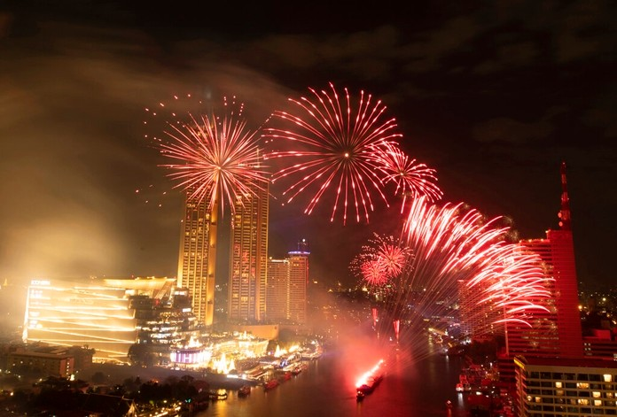 Fireworks explode over the Chao Phraya River during New Year celebrations in Bangkok, Thailand, Wednesday, Jan. 1, 2020. (AP Photo/Sakchai Lalit)