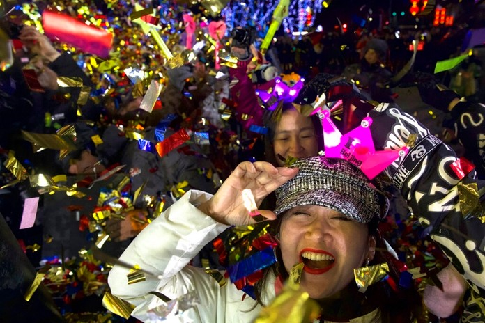 People celebrate the arrival of the year 2020 at a New Year's Eve countdown event near the 2022 Beijing Winter Olympic headquarters in Bejing, Wednesday, Jan. 1, 2020. (AP Photo/Ng Han Guan)