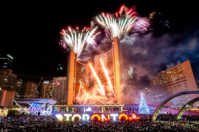 Revelers watch the New Year's fireworks after midnight at Nathan Philips Square in Toronto, Wednesday, Jan. 1, 2020. (Christopher Katsarov/The Canadian Press via AP)