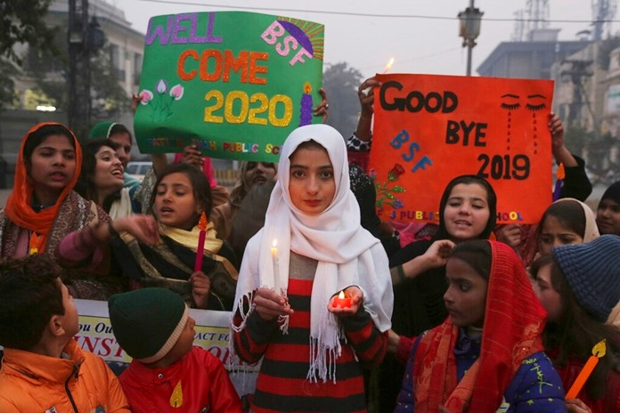 Pakistani children hold a candlelight vigil to pay tribute to victims of terrorism in 2019, at rally in Lahore, Pakistan, Tuesday, Dec. 31, 2019. (AP Photo/K.M. Chaudary)