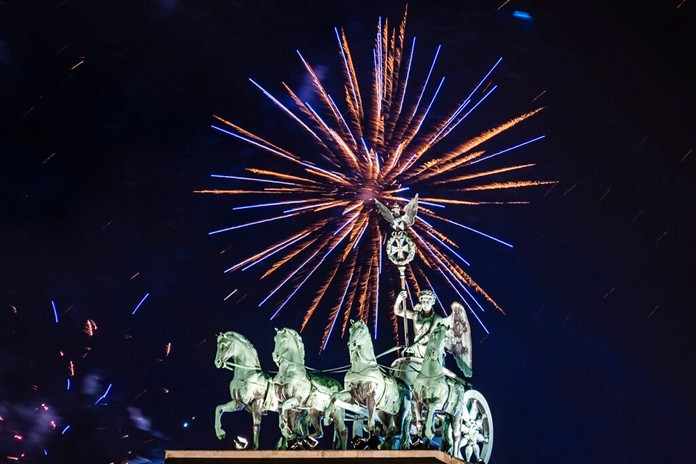 Fireworks light the sky above the Quadriga at the Brandenburg Gate during New Year celebrations in Berlin, Germany, Wednesday, Jan. 1, 2020. (Christophe Gateau/dpa via AP)