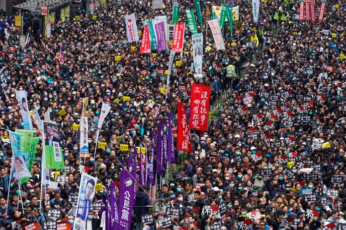 Hong Kong people participate in their annual pro-democracy march to insist their five demands be matched by the government in Hong Kong, Wednesday, Jan. 1, 2020. (AP Photo/Vincent Yu)