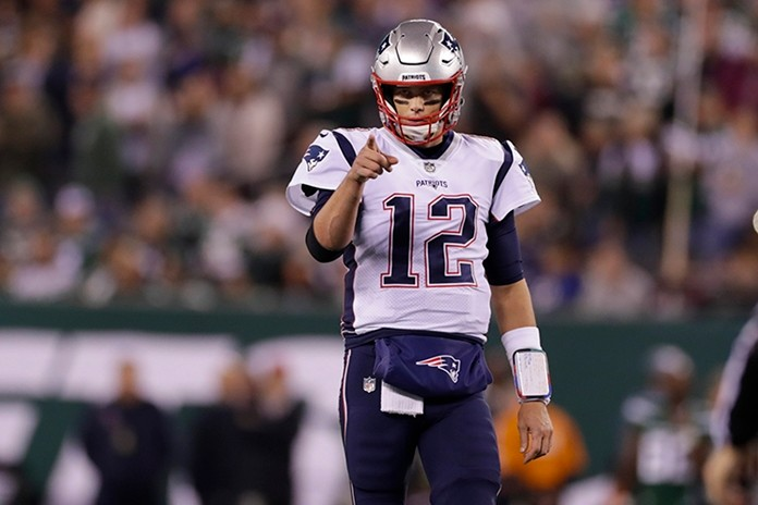 New England Patriots quarterback Tom Brady (12) points to Benjamin Watson (84) after a play during the first half of an NFL football game. (AP Photo/Adam Hunger)