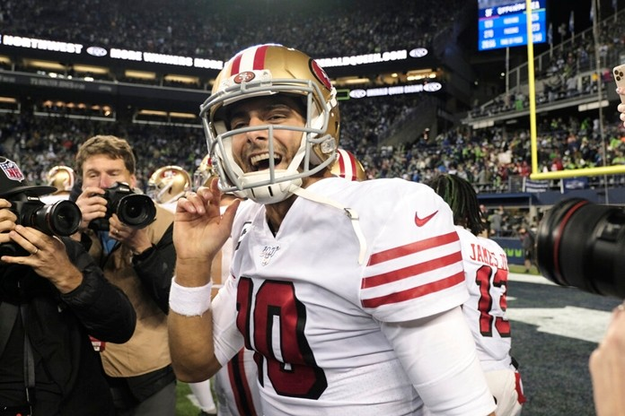 San Francisco 49ers quarterback Jimmy Garoppolo smiles after his team beat the Seattle Seahawks in an NFL football game, Sunday, Dec. 29, 2019, in Seattle. (AP Photo/Stephen Brashear)