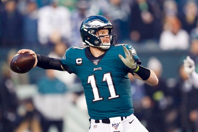 Philadelphia Eagles quarterback Carson Wentz throws a pass during the first half of an NFL football game against the Dallas Cowboys Sunday, Dec. 22, 2019, in Philadelphia. (AP Photo/Michael Perez)