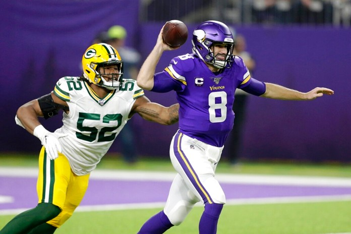 Minnesota Vikings quarterback Kirk Cousins throws a pass in front of Green Bay Packers linebacker Rashan Gary (52) during the first half of an NFL football game Monday, Dec. 23, 2019, in Minneapolis. (AP Photo/Andy Clayton-King)
