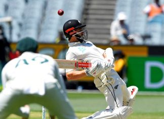 New Zealand's Kane Williamson avoids a bouncer from Australia's Pat Cummins during their cricket test match in Melbourne, Australia, Sunday, Dec. 29, 2019. With the three-test series between Australia and New Zealand decided, players from both teams will momentarily turn their attention away from the pitch at the Sydney Cricket Ground and to the deadly wildfires around the country. (AP Photo/Andy Brownbill)