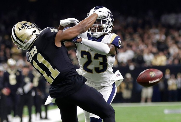 In this Jan. 20, 2019, file photo, Los Angeles Rams' Nickell Robey-Coleman breaks up a pass intended for New Orleans Saints' Tommylee Lewis during the second half of the NFL football NFC championship game in New Orleans. (AP Photo/Gerald Herbert, File)