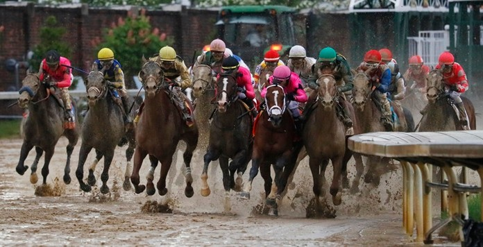 In this May 4, 2019, file photo, Luis Saez rides Maximum Security, second from right, during the 145th running of the Kentucky Derby horse race at Churchill Downs in Louisville, Ky. Country House was declared the winner after Maximum Security was disqualified following a review by race stewards. (AP Photo/John Minchillo, File)