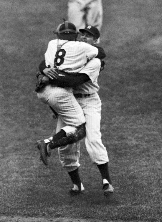 In this Oct. 8, 1956, file photo, New York Yankees catcher Yogi Berra leaps into the arms of pitcher Don Larsen after Larsen struck out the last Brooklyn Dodgers batter to complete his perfect game during Game 5 of the World Series in New York. (AP Photo/File)
