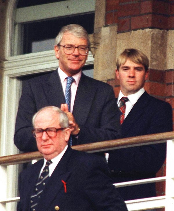In this Aug. 25, 1996 file photo, Britain's Prime Minister at the time, John Major watches play at the Oval as Pakistan played England in the third and final test between the two sides. (David Cheskin/PA via AP, File)