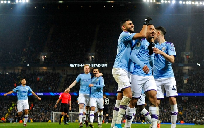 Manchester City's Gabriel Jesus, second right, celebrates with teammates after scoring his side's opening goal during the English Premier League soccer match between Manchester City and Everton at Etihad stadium in Manchester, England, Wednesday, Jan. 1, 2020. (AP Photo/Rui Vieira)