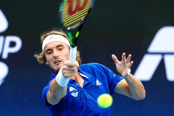 Stefanos Tsitsipas of Greece plays a shot during his match against Denis Shapovalov of Canada at the ATP Cup tennis tournament in Brisbane, Australia, Friday, Jan. 3, 2020. (AP Photo/Tertius Pickard)