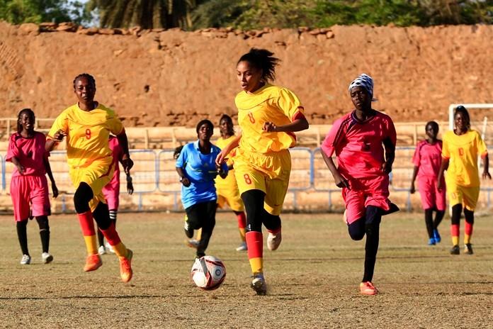In this Wednesday, Dec. 11, 2019 photo, Sudanese al-Difaa, in yellow, and al-Sumood women teams play in Omdurman, Khartoum's twin city, Sudan. (AP Photo)