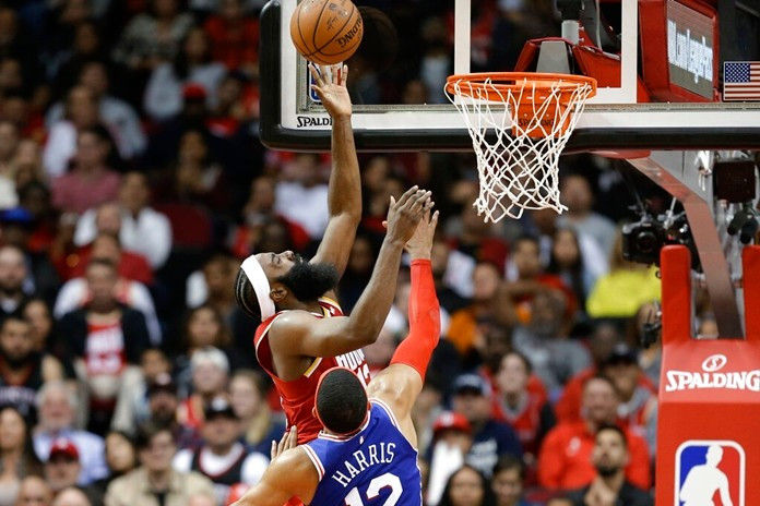 Houston Rockets guard James Harden, rear, drives to the basket as as Philadelphia 76ers forward Tobias Harris defends during the second half of an NBA basketball game Friday, Jan. 3, 2020, in Houston. (AP Photo/Eric Christian Smith)