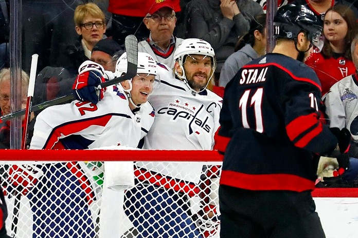 Washington Capitals' Evgeny Kuznetsov (92 is congratulated on his goal by teammate Alex Ovechkin (8), with Carolina Hurricanes' Jordan Staal (11) nearby during the second period of an NHL hockey game in Raleigh, N.C., Friday, Jan. 3, 2020. (AP Photo/Karl B DeBlaker)