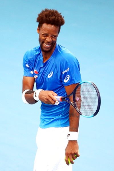 Gael Monfils of France reacts after scoring a point during his match against Cristian Garin of Chile at the ATP Cup tennis tournament in Brisbane, Australia, Saturday, Jan. 4, 2020. (AP Photo/Tertius Pickard)