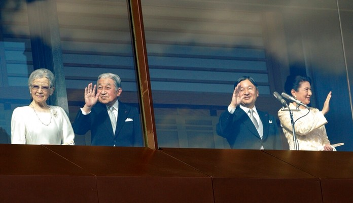 Japan's Emperor Naruhito, second from right, waves with Empress Masako, right, Empress Emerita Michiko and Emperor Emeritus Akihito to well-wishers from the bullet-proofed balcony during a public appearance with his imperial families at Imperial Palace in Tokyo Thursday, Jan. 2, 2020, in Tokyo. (AP Photo/Eugene Hoshiko)