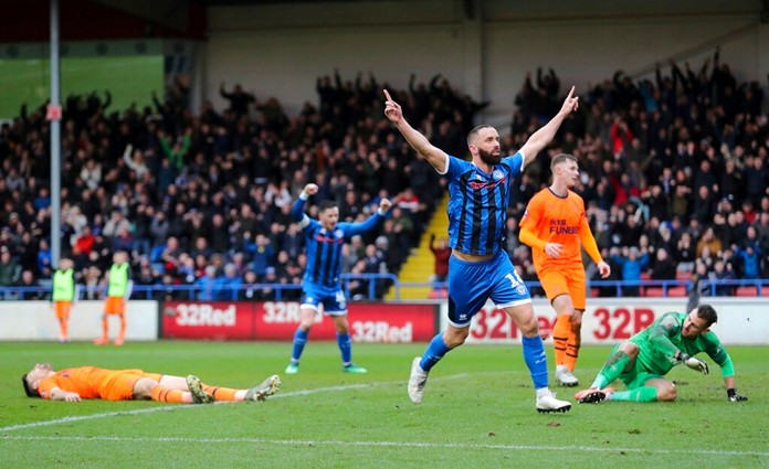 Rochdale's Aaron Wilbraham celebrates scoring his side's first goal of the game during the English FA Cup third round soccer match between Rochdale and Newcastle United at The Crown Oil Arena, Rochdale, England, Saturday, Jan. 4, 2020. Newcastle has been taken to a replay by third-tier Rochdale in the third round of the FA Cup to continue its poor recent record in the world's oldest club knockout competition. (Richard Sellers/PA via AP)