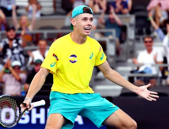 Alex de Minaur of Australia reacts after he won his match against Denis Shapovalov of Canada at the ATP Cup tennis tournament in Brisbane, Australia, Sunday, Jan. 5, 2020. (AP Photo/Tertius Pickard)