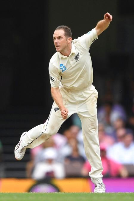 New Zealand's Todd Astle bows on day four of the third cricket test match between Australia and New Zealand at the Sydney Cricket Ground in Sydney, Australia, Monday, Jan. 6, 2020. (Andrew Cornaga/Photosport via AP)