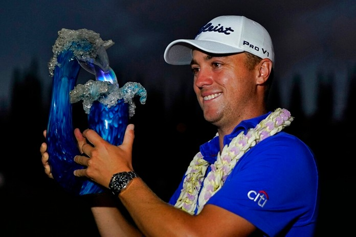 Justin Thomas holds the champions trophy after winning the Tournament of Champions golf event, Sunday, Jan. 5, 2020, at Kapalua Plantation Course in Kapalua, Hawaii. Thomas won after a three-hole playoff. (AP Photo/Matt York31