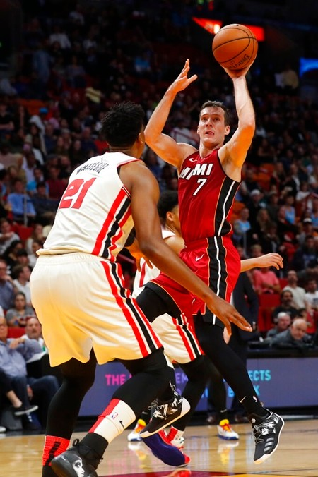 Miami Heat guard Goran Dragic (7) goes up for a shot against Portland Trail Blazers center Hassan Whiteside (21) during the second half of an NBA basketball game, Sunday, Jan. 5, 2020, in Miami. Dragic had 29 points and 13 assists as the Heat defeated the Trail Blazers 122-111. (AP Photo/Wilfredo Lee)
