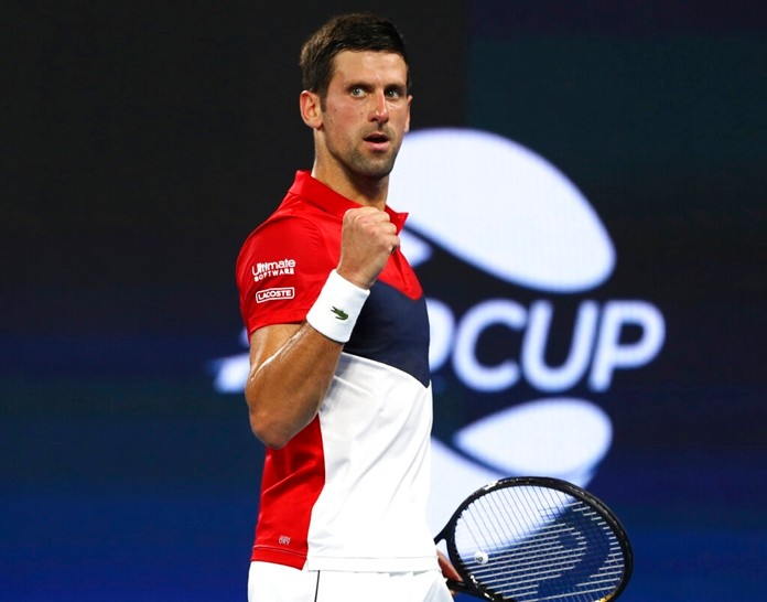 Novak Djokovic of Serbia reacts after winning a point during his match against Gael Monfils of France at the ATP Cup tennis tournament in Brisbane, Australia, Monday, Jan. 6, 2020. (AP Photo/Tertius Pickard)