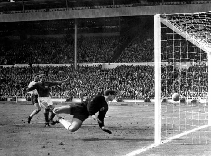 The July 30, 1966 file photo shows England's controversial third goal scored by Geoff Hurst (not in photo) past German goalkeeper Hans Tilkowski in the World Cup Final soccer match at London's Wembley Stadium. Hans Tilkowski, the West Germany goalkeeper in the 1966 World Cup final against England, has died. He was 84. (AP Photo, File)