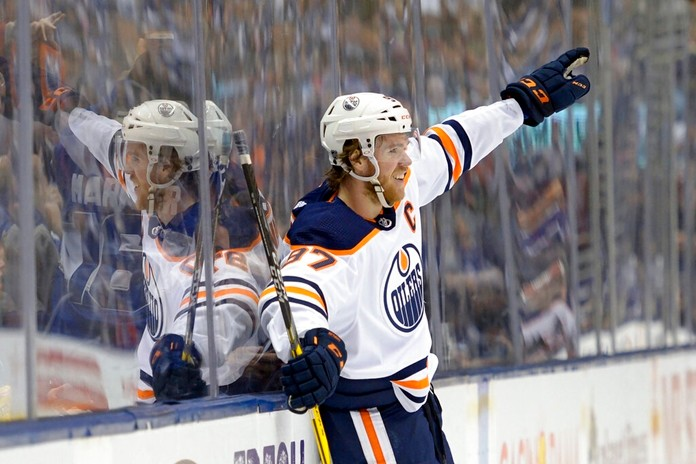 Edmonton Oilers center Connor McDavid celebrates his goal against the Toronto Maple Leafs during third-period NHL hockey game action in Toronto, Monday, Jan. 6, 2020. (Nathan Denette/The Canadian Press via AP)