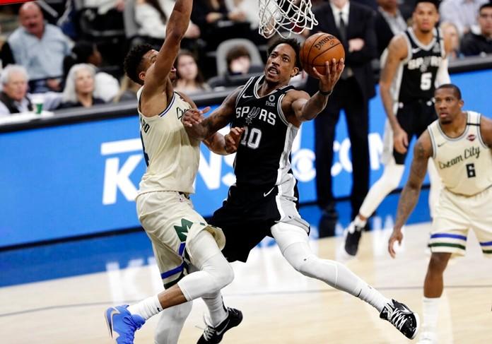 San Antonio Spurs guard DeMar DeRozan (10) scores against Milwaukee Bucks forward Thanasis Antetokounmpo, left, during the second half of an NBA basketball game in San Antonio, Monday, Jan. 6, 2020. (AP Photo/Eric Gay)