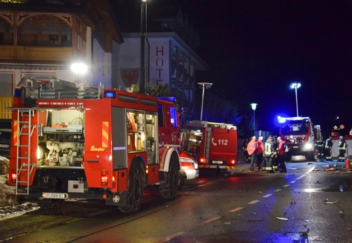 Emergency services of the Luttach voluntary fire brigade secure an accident site after a car drove into a group of people leaving a bus in Luttach, near Bruneck in the northern region South Tirol, Italy, on early Sunday, Jan. 5, 2020. (FreiwilligeFeuerwehrLuttach via AP)