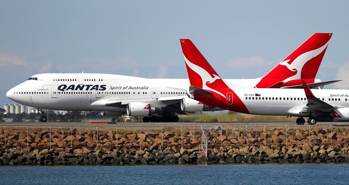 In this Aug. 20, 2015 file photo, two Qantas planes taxi on the runway at Sydney Airport in Sydney, Australia. (AP Photo/Rick Rycroft, File)