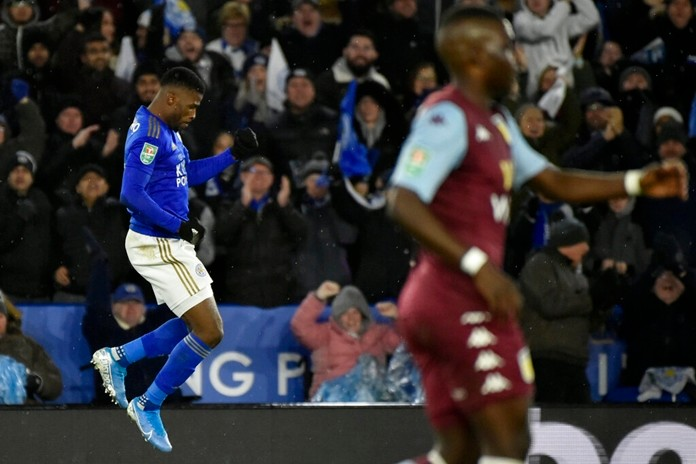 Leicester's Kelechi Iheanacho, left, celebrates after scoring his side's opening goal during the English League Cup semifinal first leg soccer match between Leicester City and Aston Villa at the King Power Stadium in Leicester, England, Wednesday, Jan. 8, 2020. (AP Photo/Rui Vieira)