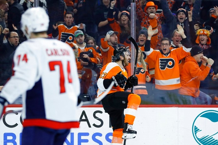 Philadelphia Flyers' Kevin Hayes, right, celebrates after scoring a goal as Washington Capitals' John Carlson watches during the second period of an NHL hockey game Wednesday, Jan. 8, 2020, in Philadelphia. (AP Photo/Matt Slocum)