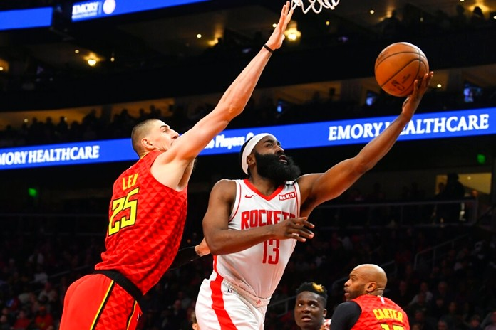 Houston Rockets guard James Harden (13) shoots as Atlanta Hawks center Alex Len defends during the second half of an NBA basketball game Wednesday, Jan. 8, 2020, in Atlanta. Houston won 122-115. (AP Photo/John Amis)