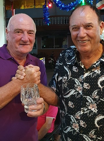 Golfer of the Month Ken Davidson receives trophy from Jimmy Carr.