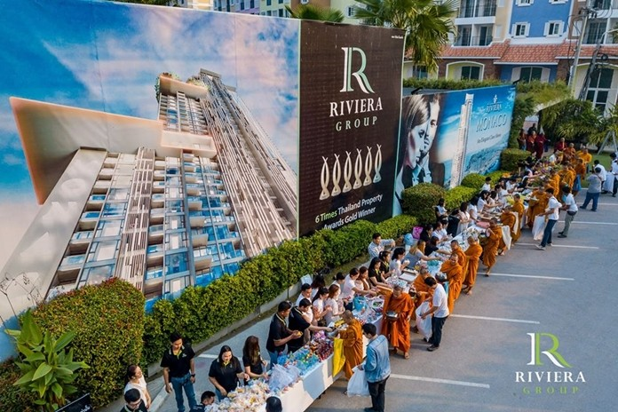 Hundreds of Riviera Group employees and their families give alms to the 99 monks.